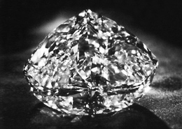 lit diamond against black background