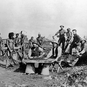 Diamond miners examining excavated soil