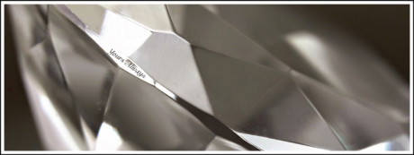 A diamond is placed in front of a laser to inscribe a special message on the girdle