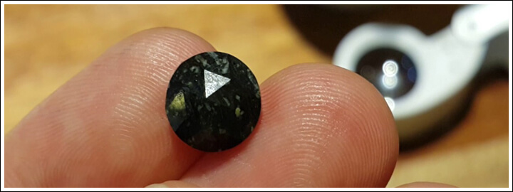 Many inclusions make the diamond appear black in colour